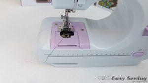 03.2-place-bobbin-into-sewing-machine
