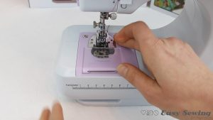 03.6-thread-to-the-back-and-replace-bobbin-cover